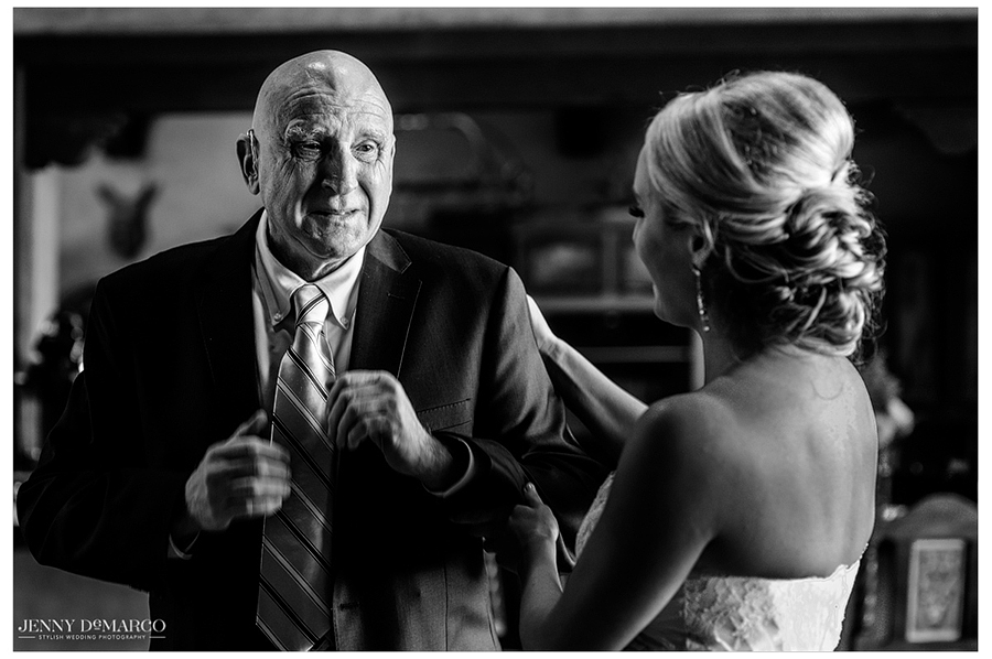 An emotional shot of the bride's Father seeing his daughter in her wedding gown for the first time.