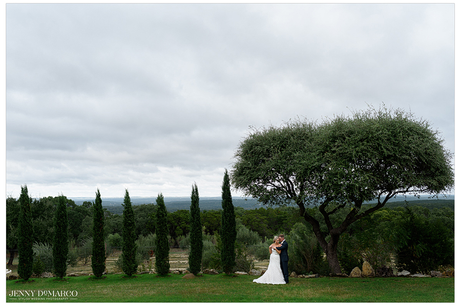 The bride and groom embrace against the beautiful backdrop of the Rancho Mirando Luxury Guest Ranch.