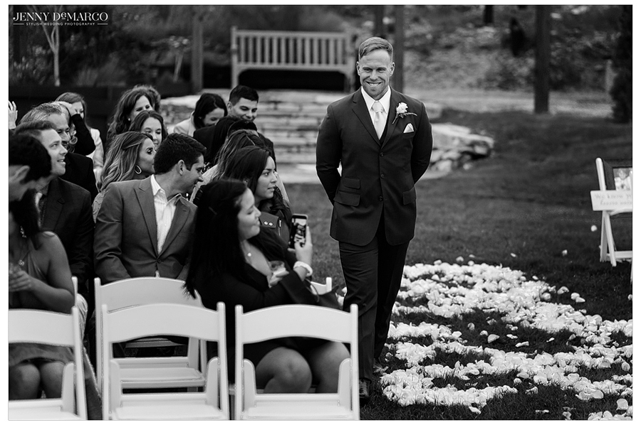 Dallas smiles as he walks down the aisle to await his bride.