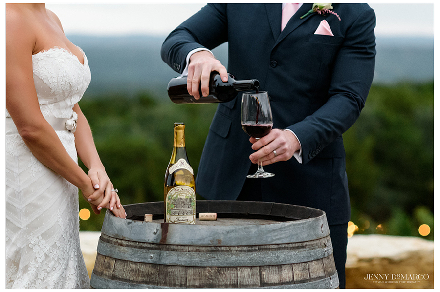 The bride and groom share a glass of wine to commemorate this joyous moment together and celebrate their marriage.