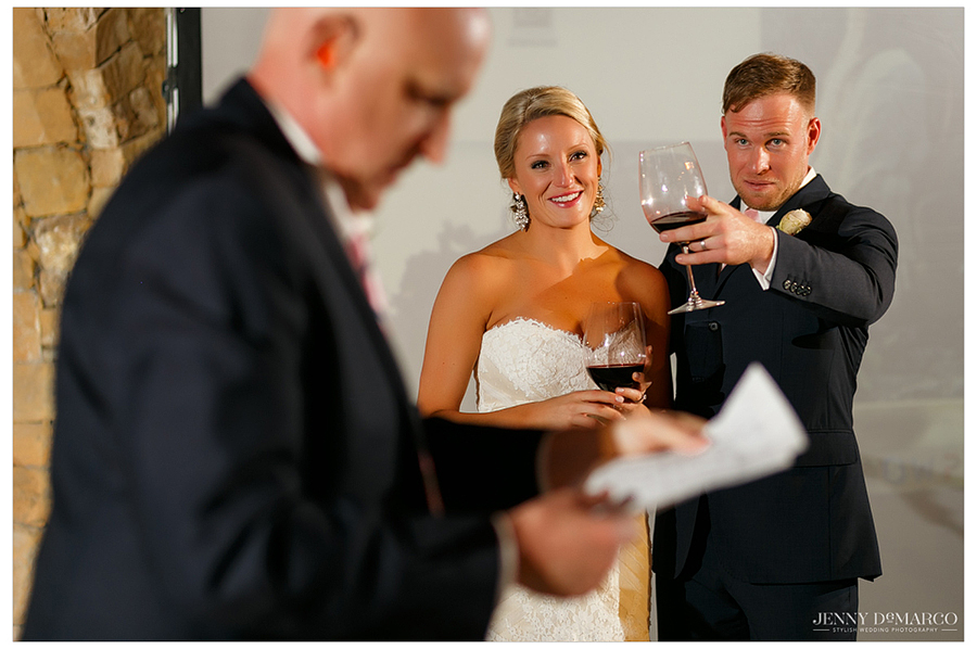 Dallas raises his glass to his Best Man during his speech.