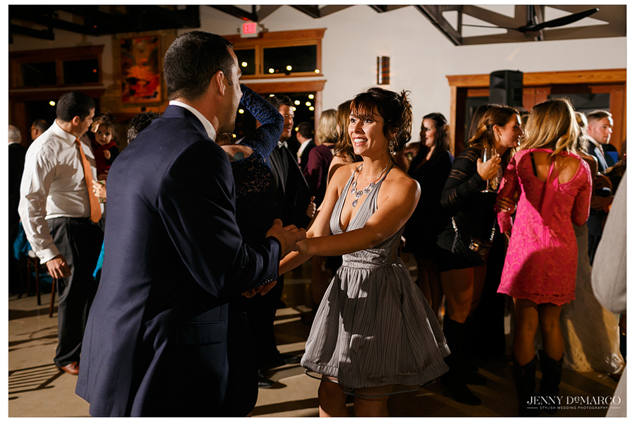 Several guests dance in the Pavilion with one another.