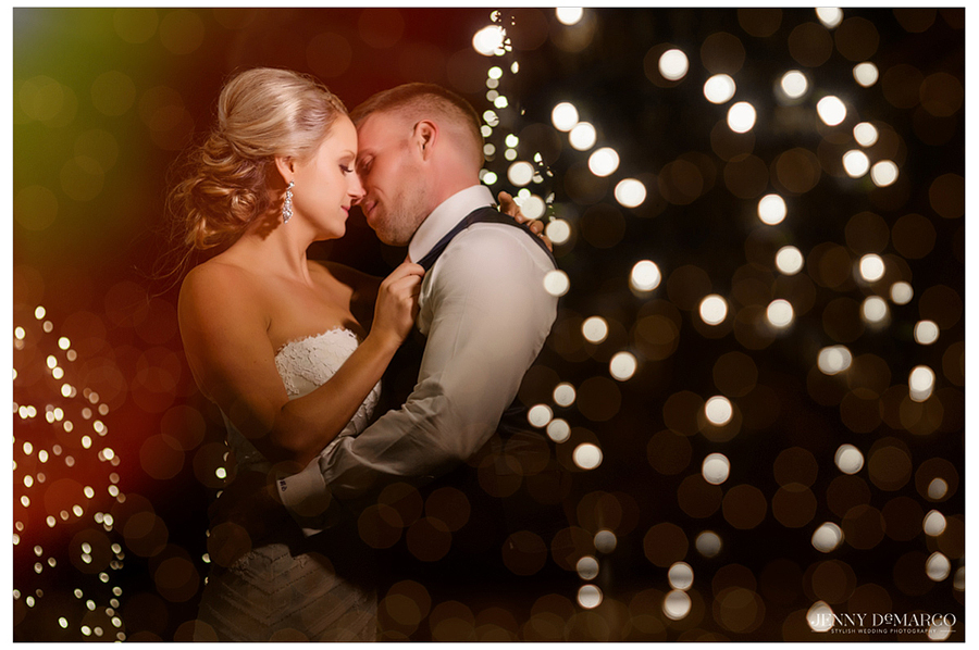 Amy and Dallas share a private moment together underneath the lights of the outdoor Pavilion at the Rancho Mirando Luxury Guest Ranch, shot by Jenny DeMarco, the best wedding photographer in Texas.
