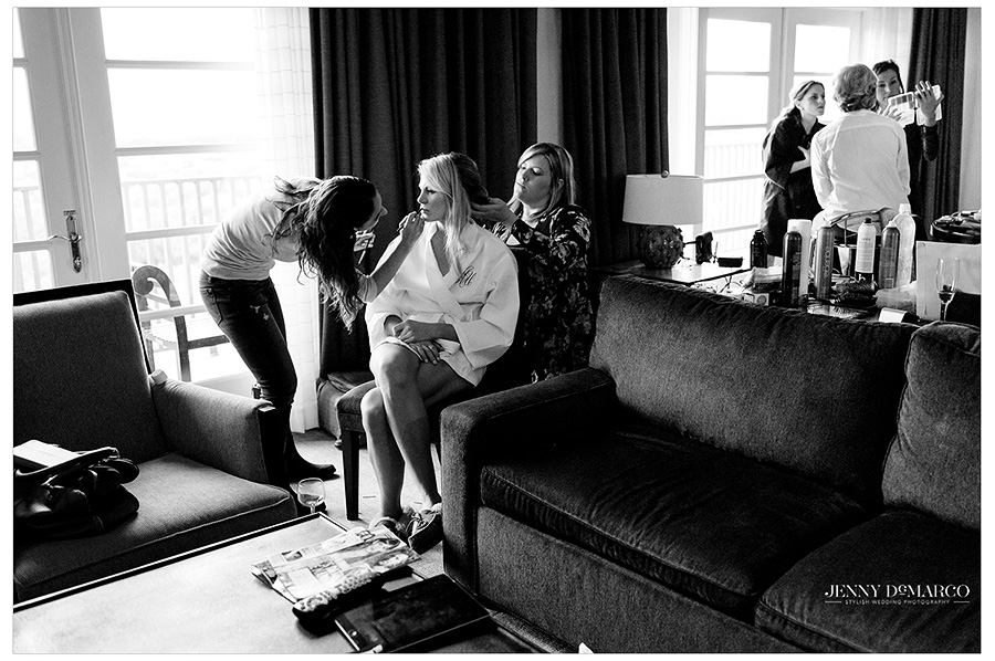 Bride and bridesmaids having their hair and makeup done in one of the hotel suites.