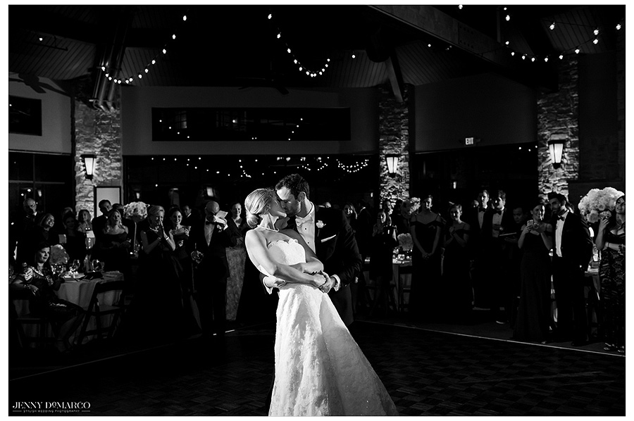 Bride and Groom share their first dance as husband and wife. Kyle kisses Hunter in this black and white image.