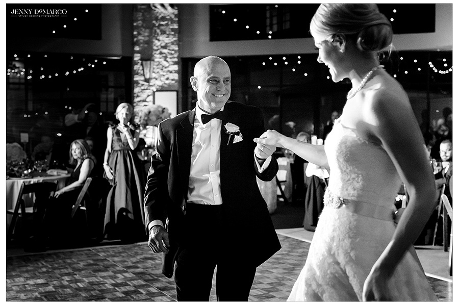 Hunter's father leads her in a spin in the bride and father dance. The image is in black and white.