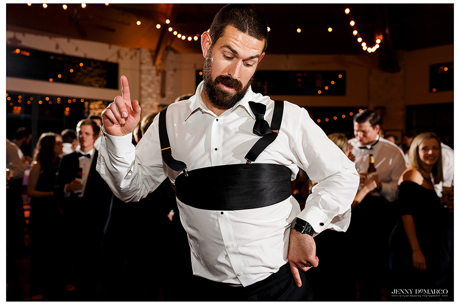 A goofy groomsman dances around the Barton Creek pavilion during the reception.
