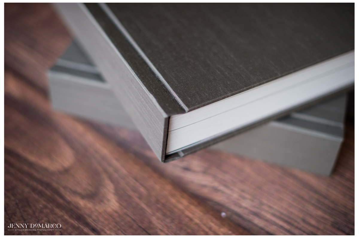 up close photograph of two grey silk wedding album covers