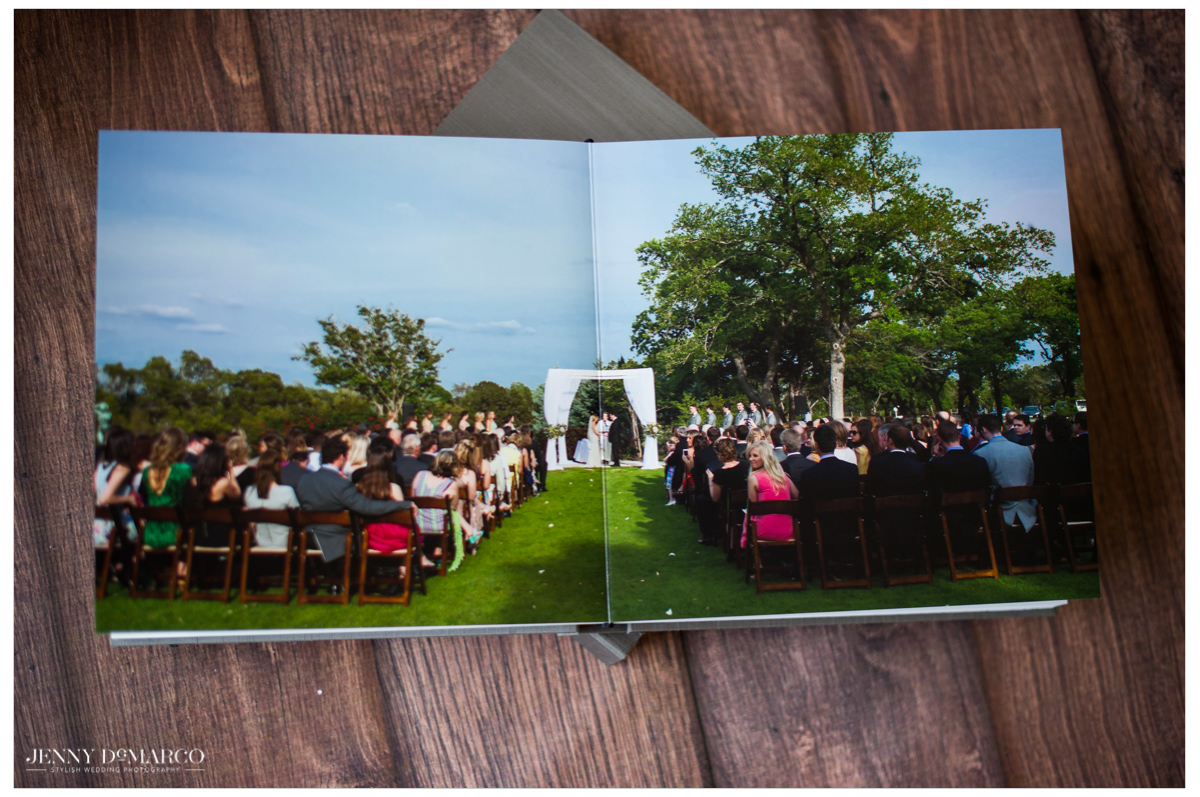 wedding album open to full page spread of an outdoor wedding ceremony