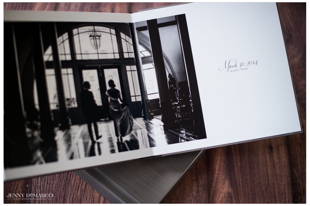 wedding album open to first page spread of bride and groom holding hands in their hotel venue