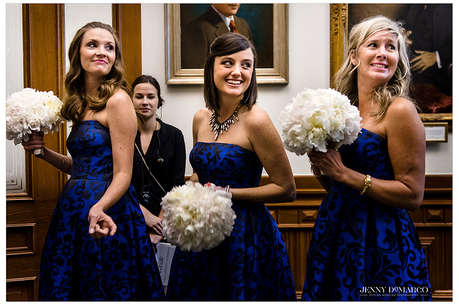 The bridesmaids smile just moments before the bride makes her grand entrance.