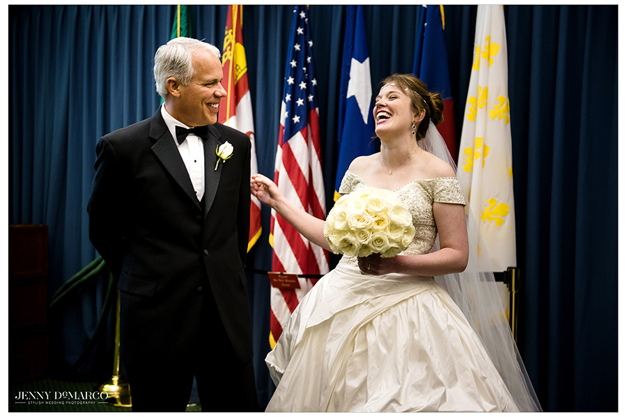 The bride and her father wait in the Senate conference room of the Texas State Capitol and joke and laugh while they wait to make their entrance.