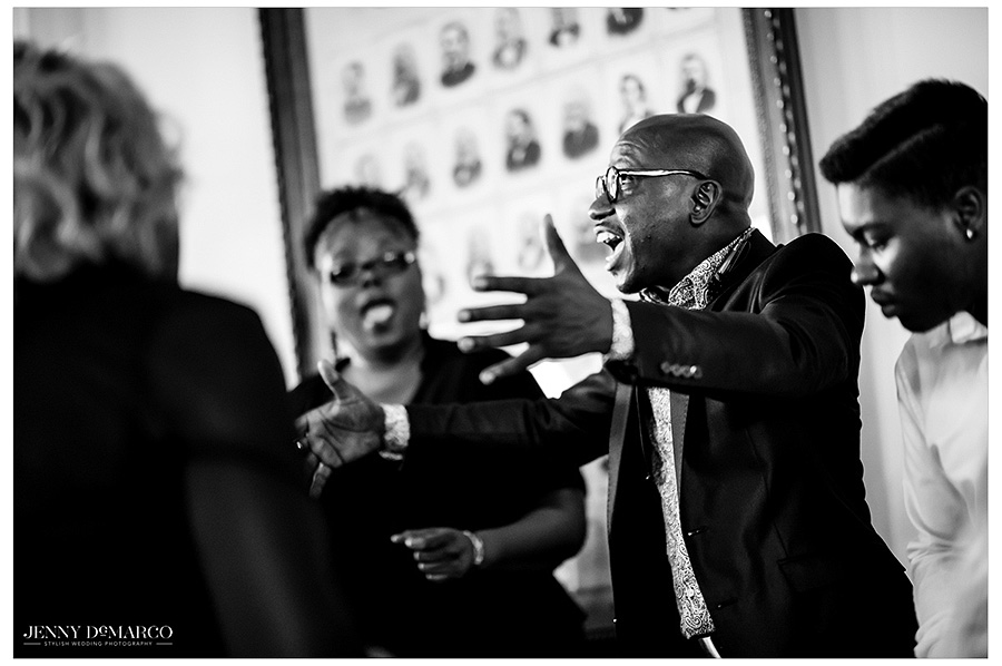 Black and white shot of the gospel choir praising the union of the bride and groom.