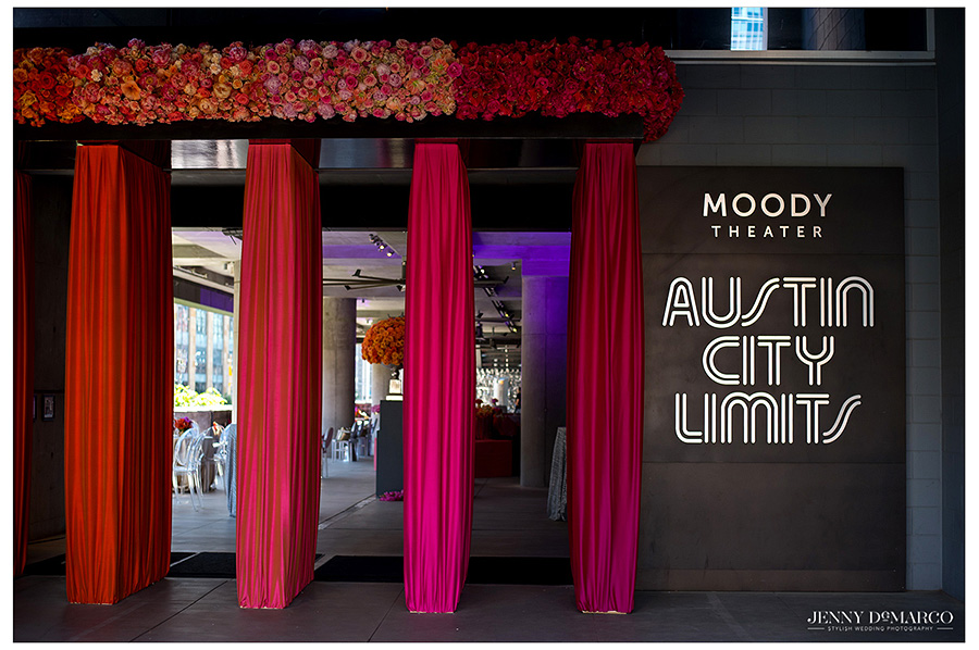 Bright fuchsia range colors custom draping juxtaposed next to the ALC Moody Theater sign.