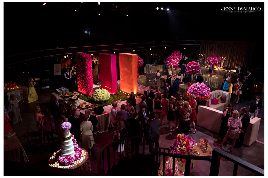 An overhead image of the party reception venue shows guest enjoying the mood lighting and bright colors.