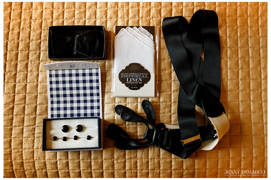 A detail photo of the groom's accessories which includes imperial linens and a bowtie.