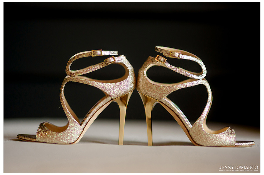 A detail photo of the bride's wedding day gold Jimmy Choo shoes.
