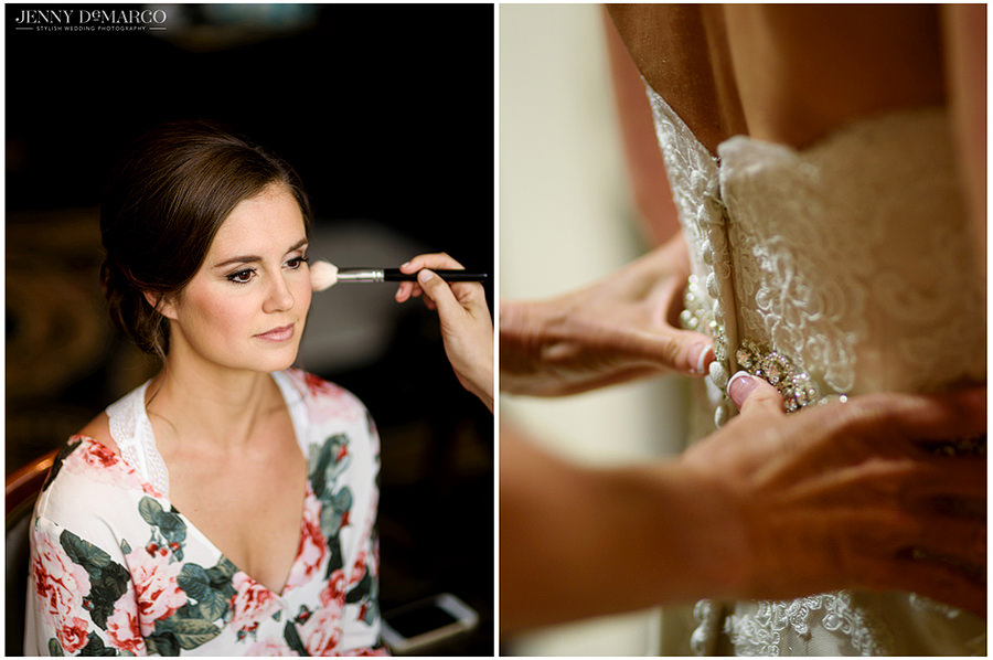 A side by side portrait of the bride getting her make up done and having the back of her wedding dress zipped and buttoned.