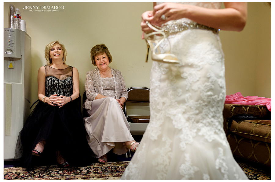The mother of the groom and the grandmother of the bride take their final look at the bride before the wedding.