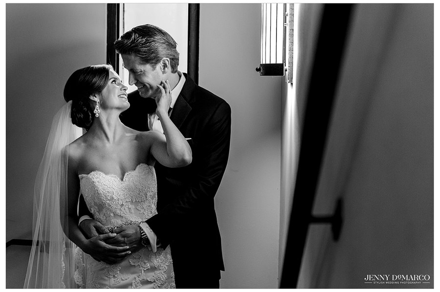 A black and white photo of the bride and groom hugging and looking into each other's eyes.