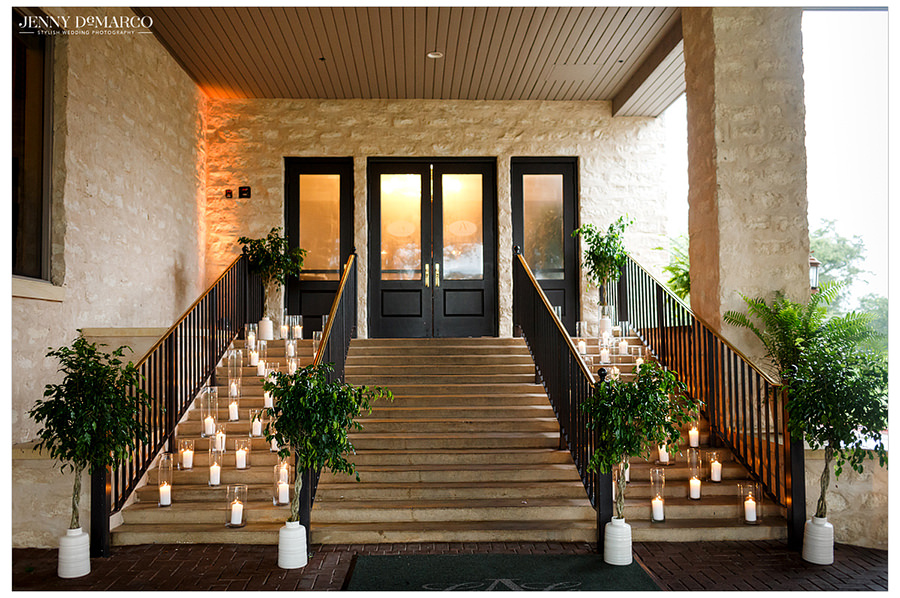 The stairs and entrance of the church lined with candles.