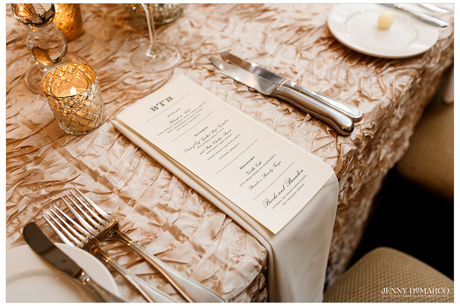 A photo of the dinner table and monogrammed dinner menu with each course.