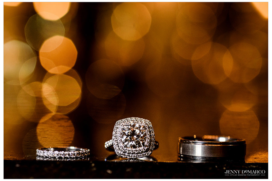 A picture of the engagement band, wedding ring, and the rooms wedding band.