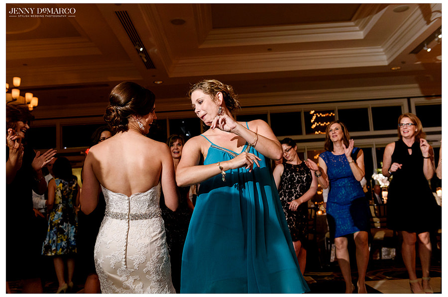 The bride and one her guests dance together on the dance floor of the Austin Country Club.