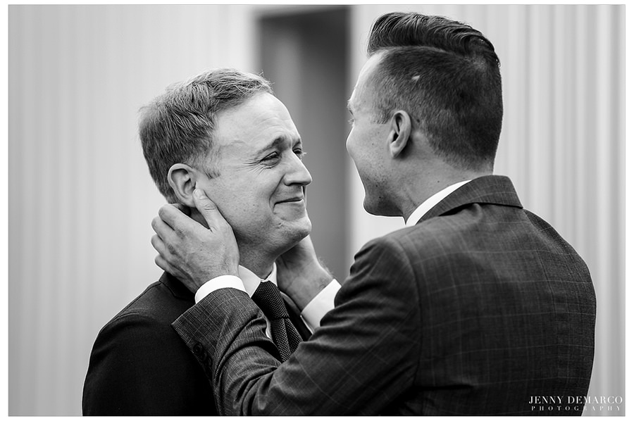 Grooms share an emotional moment before the wedding.