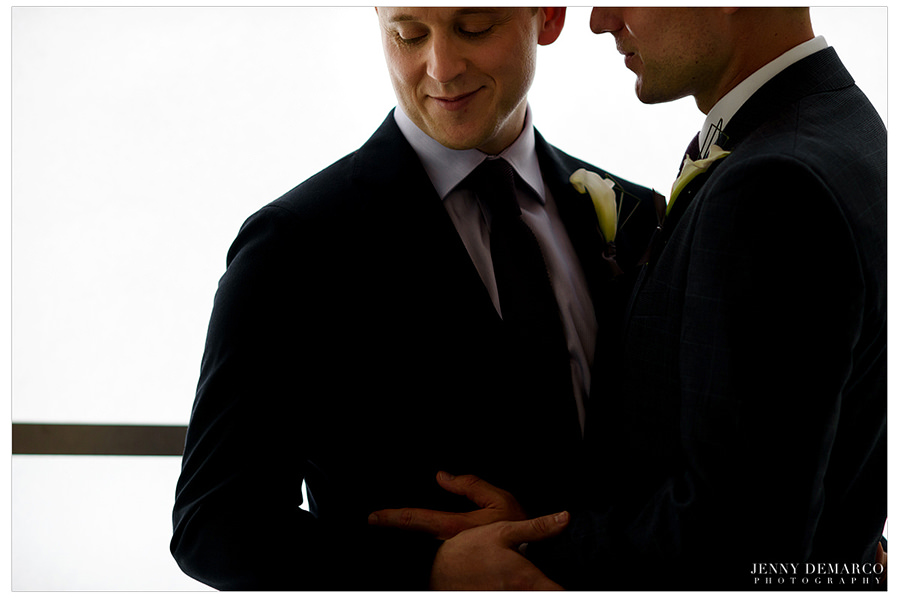 Grooms embrace before the wedding.