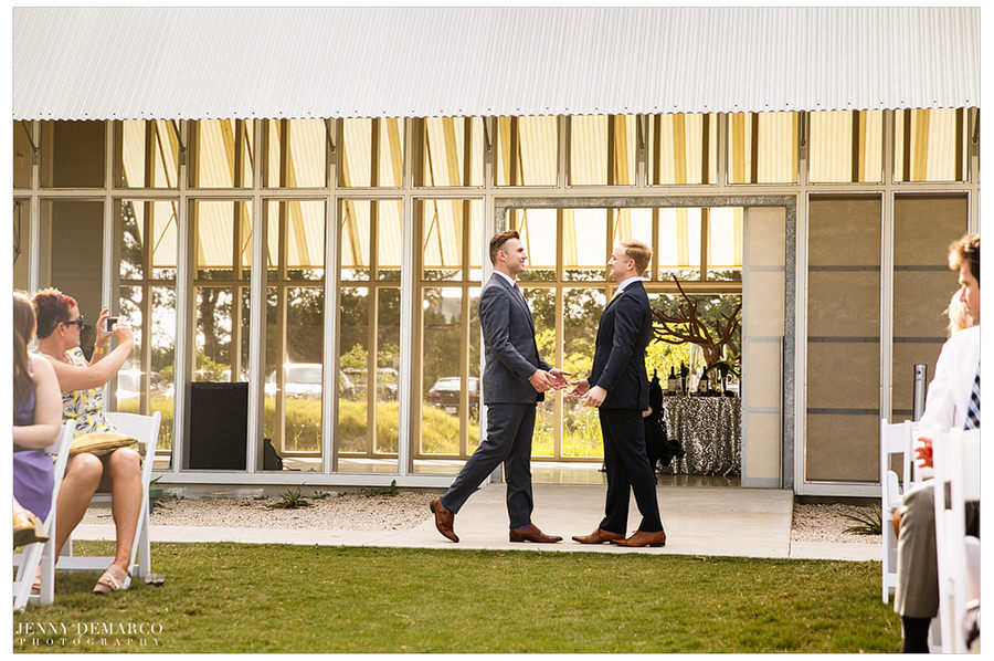 Grooms meet to walk each other down the aisle.