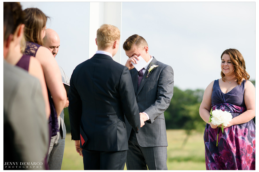 One groom cries during wedding ceremony.