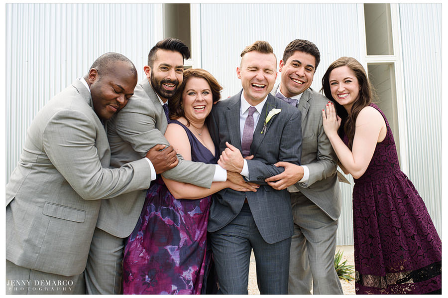 Groom laughs with friends.