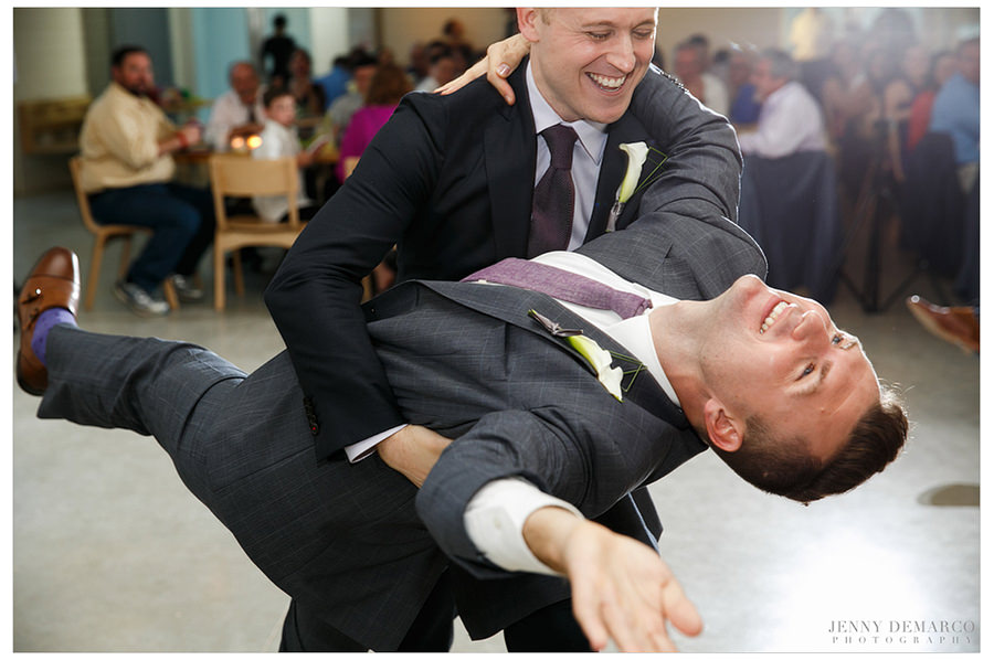 A groom dips his new husband during the first dance.