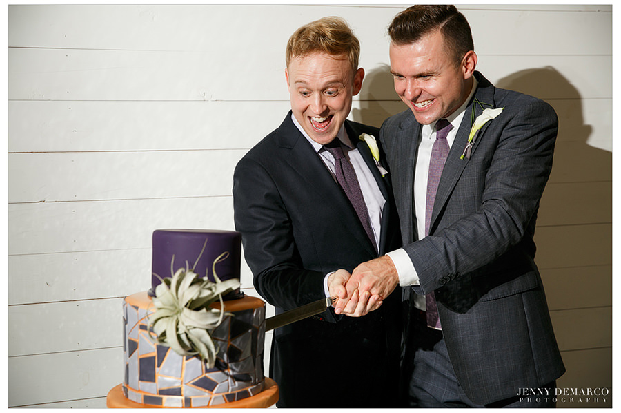 The grooms cut their beautiful cake!