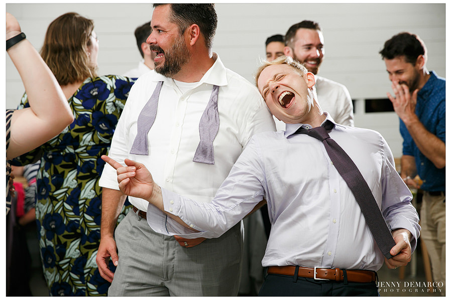 Laughing and dancing during a lively wedding reception!
