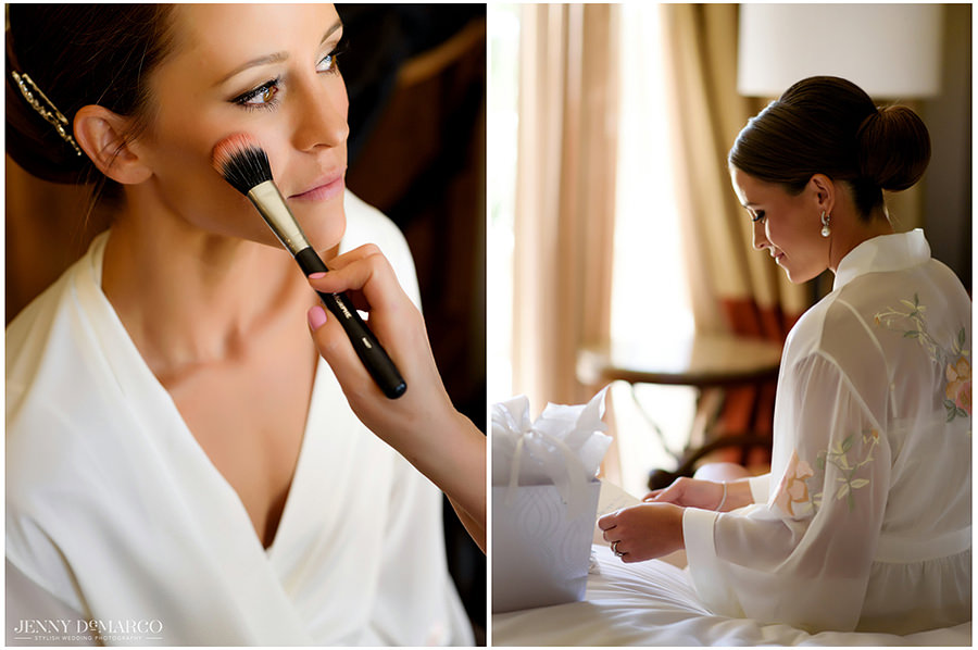 A side by side portrait of the bride getting her make up done and opening wedding day gifts.