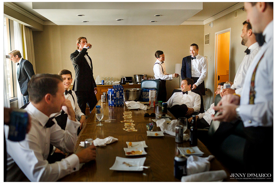 The groomsmen spend time together and eat with the groom before the wedding.