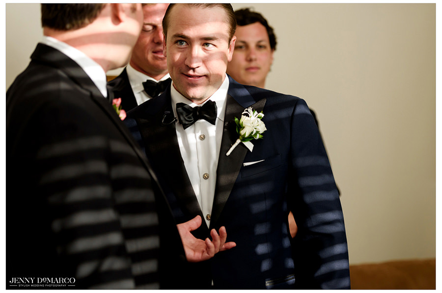 The groom spends time and shares conversation with his groomsmen before the ceremony.