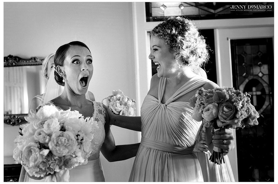 The bride shows an expression of joy and shock with her friends after the wedding now that she is officially married.