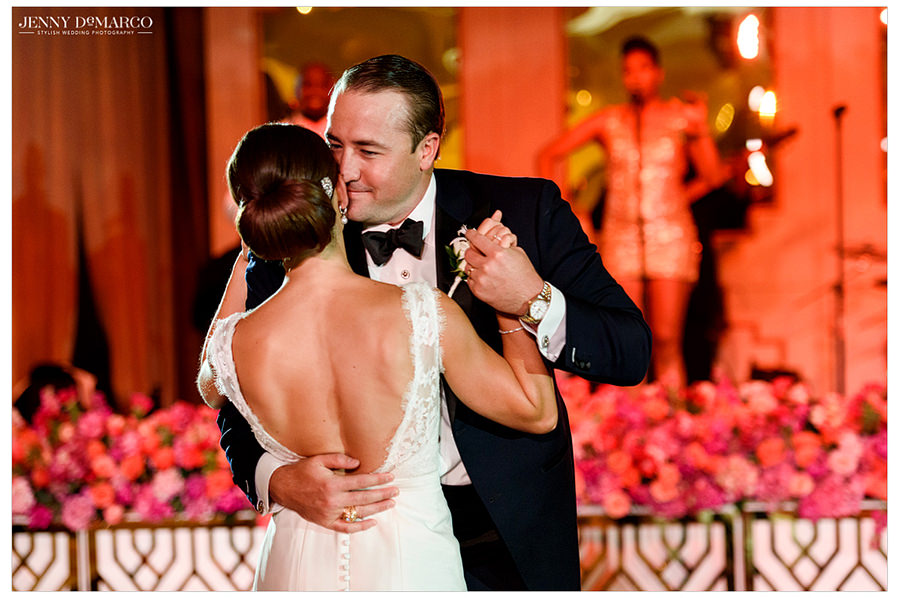 The bride and groom having their first dance after entering the reception to meet all their guests.