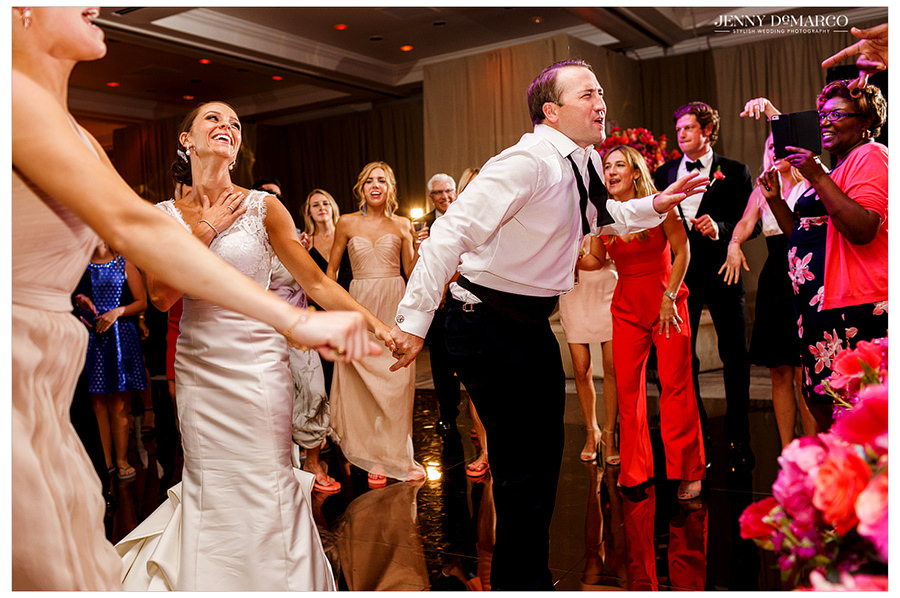 The bride and groom join their guests on the dance floor and sing along with the band.