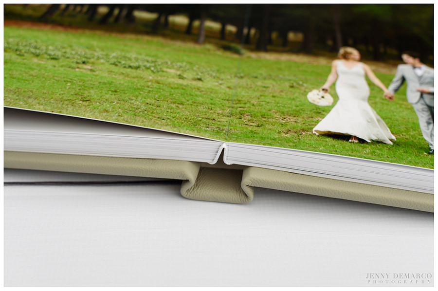 Another view of the opened spine of the wedding album, demonstrating the layflat design.