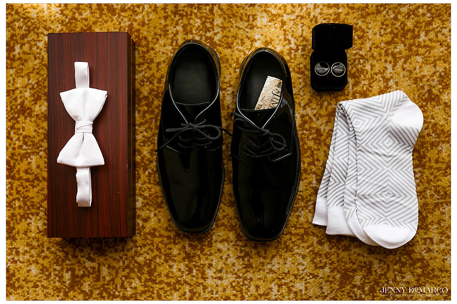 Detail of the grooms shoes and tie.