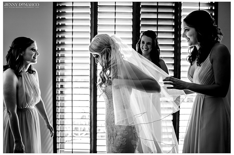 Black and white image of the bride getting ready with her wedding party.