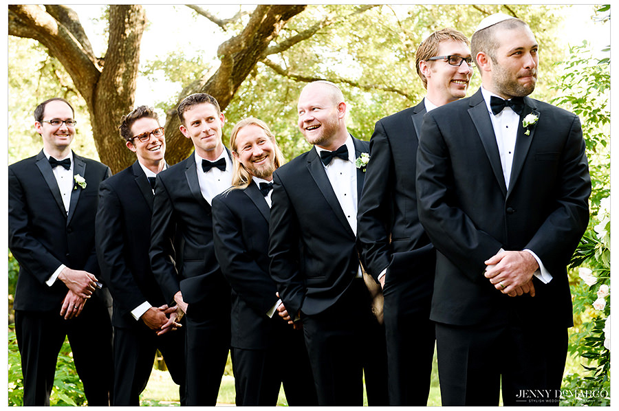 The grooms mens share a laugh during the ceremony.
