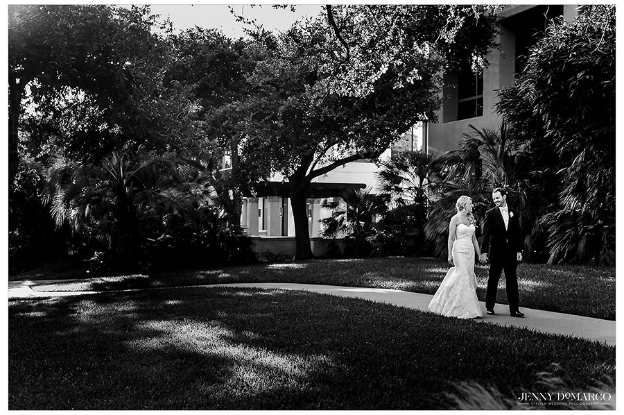 Black and white image of the bride and groom sharing a private moment after the wedding ceremony.
