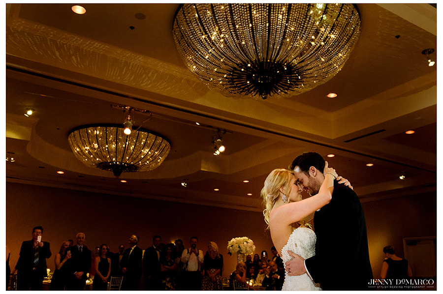 The bride and groom embrace during their first dance.