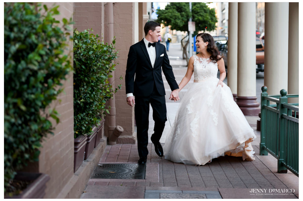 Happy couple walking outside of the Driskill after their ceremony there.
