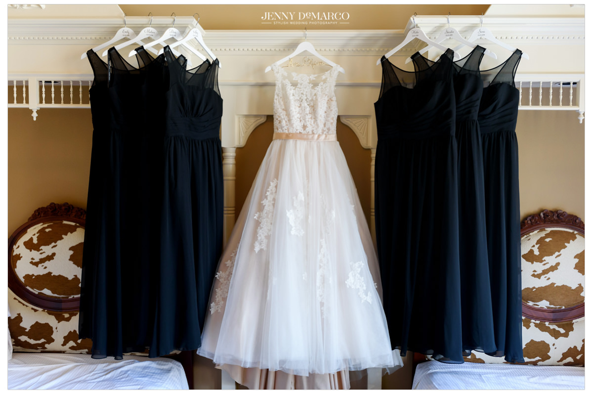 The wedding dresses and bridesmaids dresses in the hotel room.